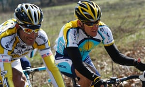 George Hincapie, left, rides with Lance Armstrong in the Milan-San Remo cycling classic in San Remo, Italy, in March 2009.