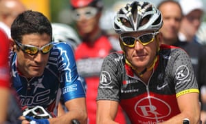 Seven-time Tour de France winner Lance Armstrong (R) is pictured with former team mate George Hincapie in this file photo from May 20, 2010 in Visalia, California at the Tour of California.