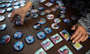 Buttons of President Barack Obama are displayed at a table set up by the Three Peaks Independent Democrats in the Upper West Side of Manhattan.