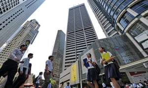 People walk near highrises building in singapore