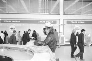 Led Zeppelin: Led Zeppelin lead singer Robert Plant standing at counter