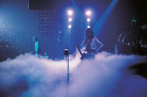 Led Zeppelin: Dry ice fills the stage as Jimmy Page plays a theramin in 1977