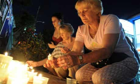 A tourist lights a candle near the memorial for victims of the 2002 Bali bombings
