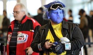 Fans arrive for the opening session of the 2012  New York Comic Con at the Jacob Javits Center.