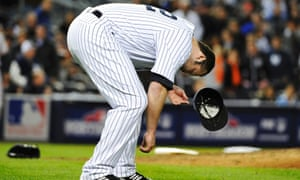 Joba Chamberlain is down and out after being hit with a broken bat as Matt Wieter's singled to open the 12th inning.