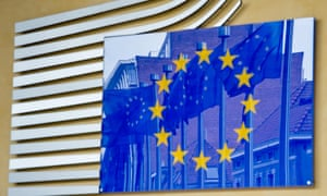 European flags are reflected in another European flag at the European Commission headquarters in Brussels, Friday, Oct. 12, 2012.