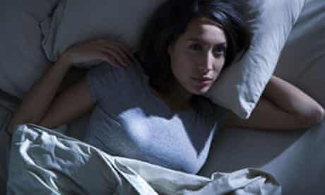 Woman in bed alone
