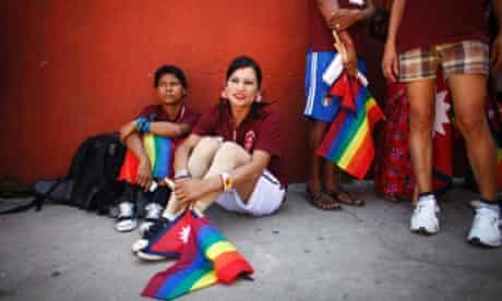 Members of the Lesbian, Gay, Bisexual and Transgender (LGBT) community hold the gay pride flag during the opening ceremony of the 1st South Asian LGBT Games in Katmandu, Nepal. Around 250 LGBT community members are participating in the games.