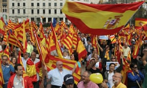 Thousands gather at Catalonia square in Barcelona, northeastern Spain, 12 October 2012, claiming the country's unity with Spanish and European flags  during the Columbus Day celebrations.