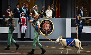 A goat, the mascot of La Legion, an elite unit of the Spanish Army, marches in front of the tribune where Spain's Crown Prince Felipe, left, Spain's King Juan Carlos, center, and Queen Sofia attend a military parade, during the holiday known as Dia de la Hispanidad, Spain's National Day, in Madrid, Friday, Oct. 12, 2012.