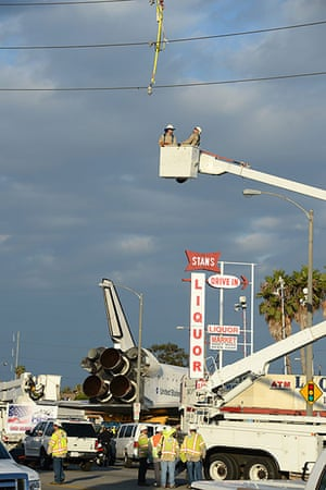 Endeavour: Utility workers prepare to lower utility