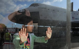 Endeavour: A young spectator watches as the Space Shuttle Endeavour moves slowly past