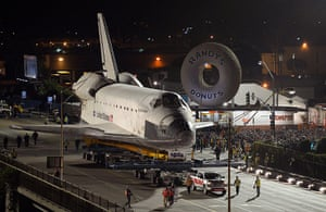 Endeavour: The Space Shuttle Endeavour is slowly moves past Randy's Donuts