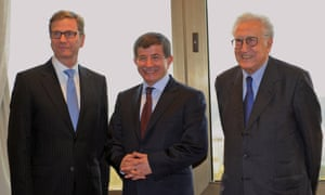 Turkish foreign minister Ahmet Davutoglu flanked by his German counterpart  Guido Westerwelle and international envoy Lakhdar Brahimi during a meeting in Istanbul on Saturday.