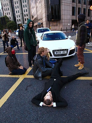 Global Noise Protests: A protester briefly blocks a road near Tower Bridge in London