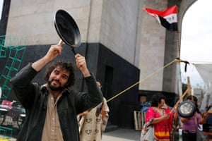 Global Noise Protests: A demonstrator bangs a saucepan with a spoon in Mexico City