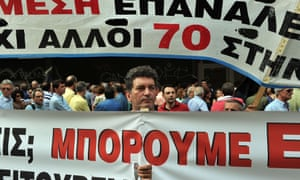 A metal worker from a factory in Thessaloniki holds a banner during a demonstration outside the labour ministry in Athens on October 15, 2012. The workers ask for the government to find a solution after the factory stopped production and ceased to pay the salaries for 17 months.