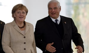 German Chancellor Angela Merkel, left, and the President of Panama, Ricardo Martinelli, right, arrive for a joint press conference after a meeting at the chancellery in Berlin, Germany, Monday, Oct. 15, 2012.