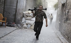 A rebel fighter retreats after firing a rocket propelled grenade against Assad's forces in Aleppo.