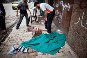 FTA: Maysun: The body of a child lies in front of Dar al Shifa hospital
