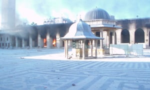 Fire burns after shelling at the Umayyad mosque in Aleppo on Saturday.