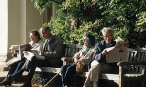 Two elderly couples reading newspapers
