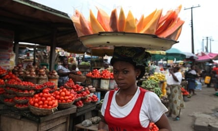 A woman carries fruit to sell in the market on World Food Day in Lagos, Nigeria. The UN's Food and Agricultural Organization is marking World Food Day to highlight the importance of global food security. The FAO said hunger is declining in Asia and Latin America but is rising in Africa. One in eight people around the world goes to bed hungry every night.