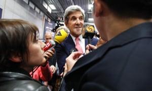 Senator John Kerry speaks to reporters in the media filing room ahead of the second presidential debate at Hofstra University.