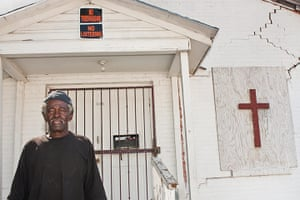 Big Picture: Dallas: Man in front of a church with a sign that says no loitering