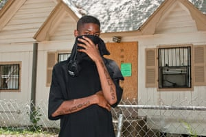 Big Picture: Dallas: Young man hiding his face with South Dallas tattooed on his arms
