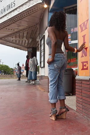 Big Picture: Dallas: Back view of a young woman in front of a shop