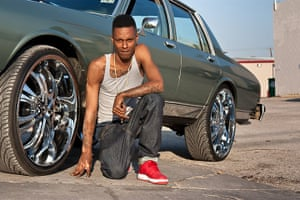 Big Picture: Dallas: Young man in front of car