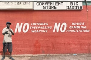 Big Picture: Dallas: Man stood in front of sign saying no trespassing or loitering