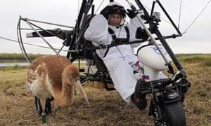 Russian president Vladimir Putin in hang gilder with crane