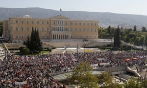 Members of the PAME Communist-affiliated union gather outside the Greek parliament during a 24-hour nationwide general strike in Athens, Thursday, Oct. 18, 2012.