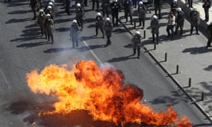 Protesters throw petrol bombs against riot police during a 24-hour nationwide general strike, Athens, Thursday, Oct. 18, 2012