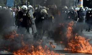 Greek riot police clashes with demonstrators during a 24-hour strike in Athens on October 18, 2012.
