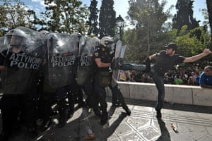 Greece protests: A demonstrator clashes with riot police