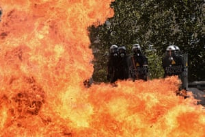 Greece protests: A firebomb explodes in front of the riot police