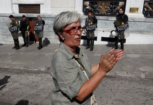 Greece protests: A woman applauds members of Greece's Communist Party