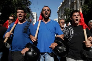Greece protests: Members of Greece's Communist Party take part in a march