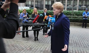 Lithuanian President Dalia Grybauskaite, right, speaks with the media.