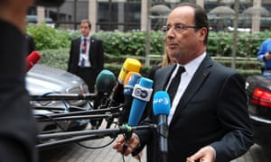 French President Francois Hollande speaks with the media as he arrives for an EU summit in Brussels on Thursday, Oct. 18, 2012.