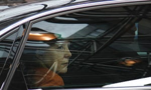 German Chancellor Angela Merkel, inside car, looks out of her window as she arrives for an EU summit in Brussels on Thursday, Oct. 18, 2012.