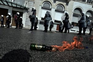 Greece protest update: A molotov cocktail burns in front of riot police