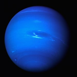 Voyager: Neptune glows a brilliant blue in the night sky seen by Voyager 2