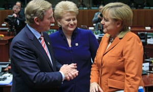 Ireland's Prime Minister Enda Kenny (L), Lithuania's President Dalia Grybauskaite (C) and Germany's Chancellor Angela Merkel speak during an European Union leaders summit at the European Council headquarters in Brussels October 18, 2012.