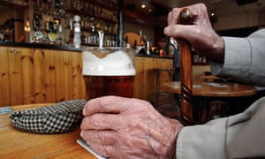 Older man holding a pint of bitter