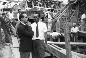 Oscar Niemeyer: Niemeyer, with hand on chin, inspects the site of an office block
