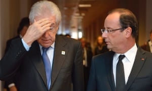 Italian Prime Minister Mario Monti, left, and French President Francois Hollande walk after a bilateral meeting on the sidelines of the EU summit in Brussels on Thursday, Oct. 18, 2012.